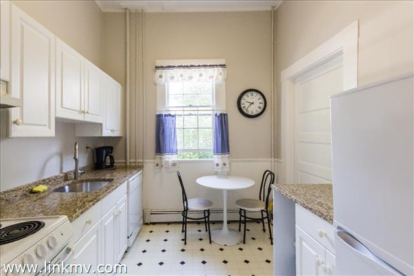 Newly renovated galley kitchen off the dining room.