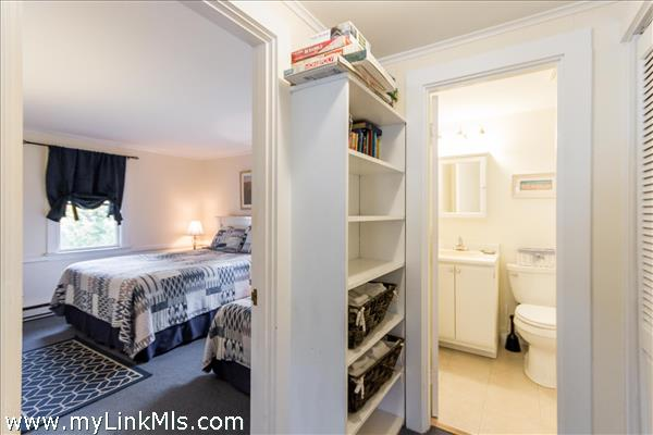 Hallway features a roomy built in bookshelves, plus a large double closet with custom rack system and storage.