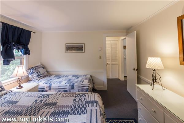Charming furnishings - both a queen and a twin bed plus bureau and nightstands.