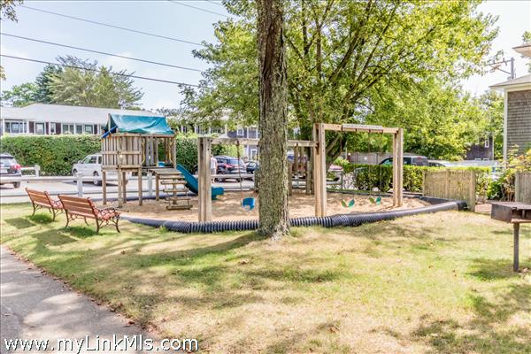 Playground and lawn areas for family fun.
