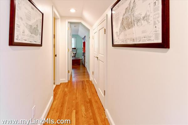 hallway leading to bath and bedroom #3 on upper level