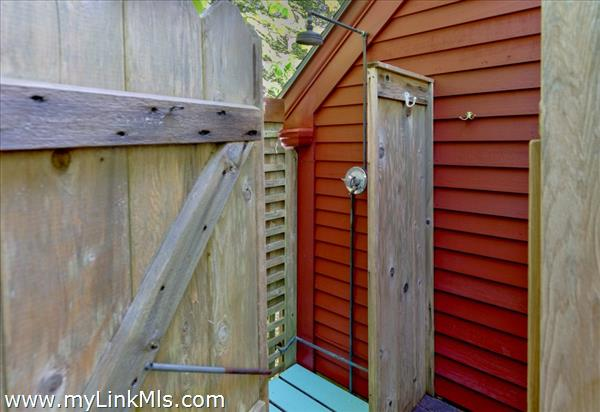 Outdoor shower off the deck by master bedroom