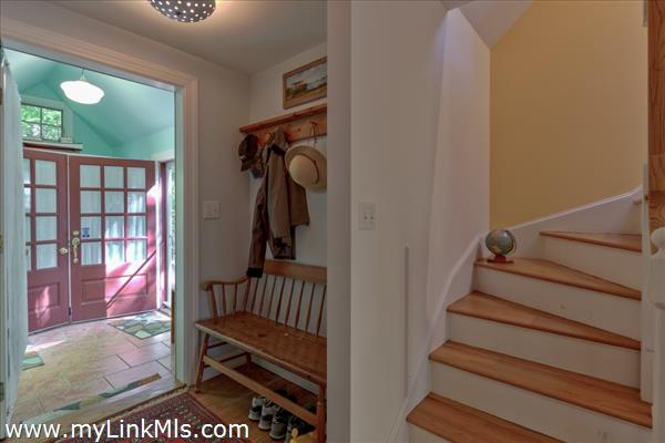 Looking from Living Room back toward main entry and stairs to upper level