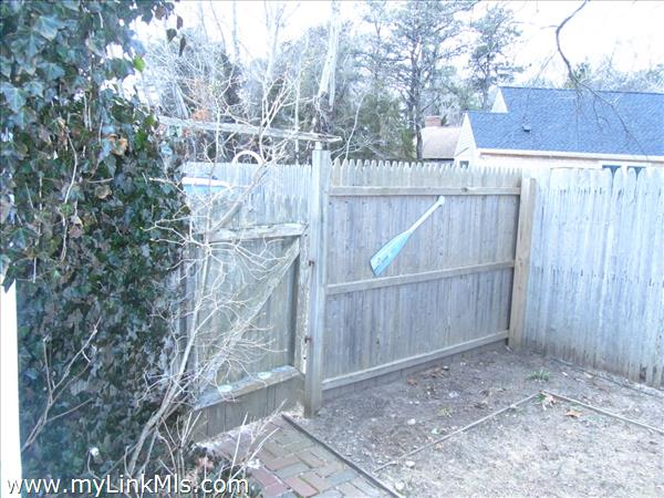 Gate to fenced backyard