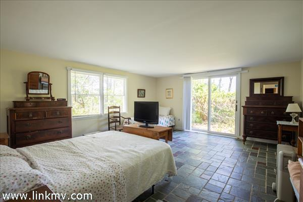 The master bedroom offers peeks of the water