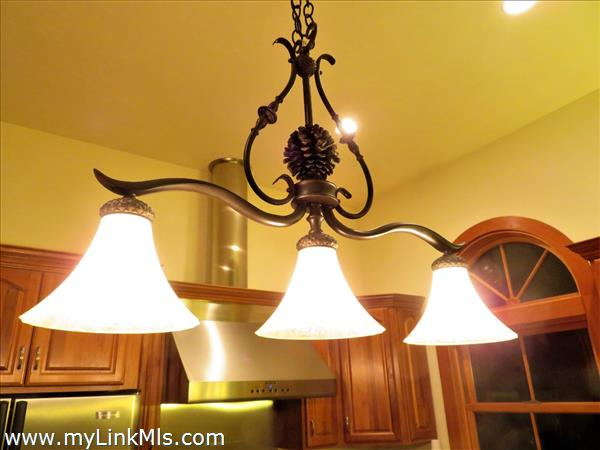 Island ceiling lighting in kitchen.