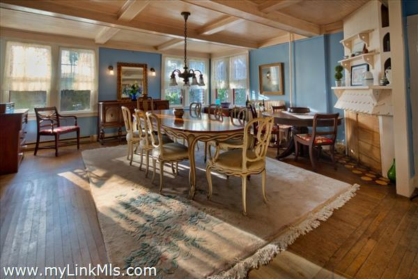 Large dining room with paneled ceiling and Dutch painted tile fireplace