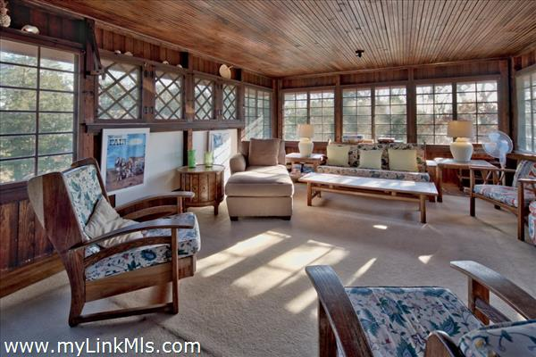 2nd floor family room with wrap around windows
