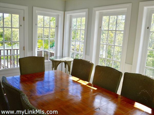 Screened porch dining off the kitchen