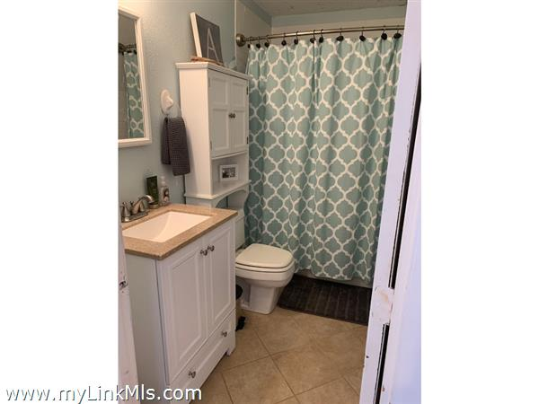 One of two tiled bathrooms