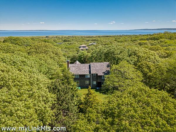 Aerial view showing the privacy around the home and the close proximity to Vineyard Sound