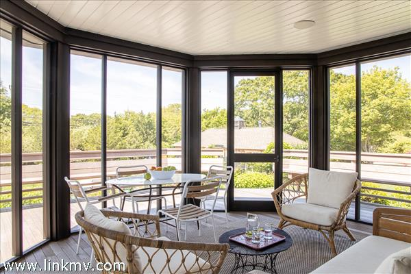 Screen porch with pool in background