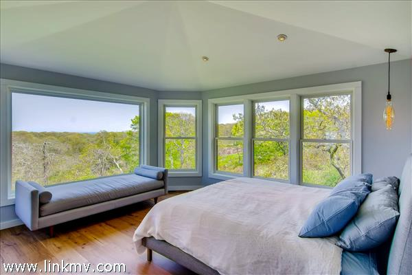 Gracious master bedroom is located in its own private wing