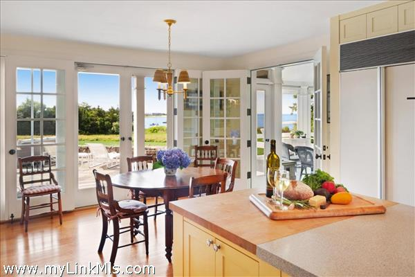 Main house kitchen with waterviews and access to screened porch