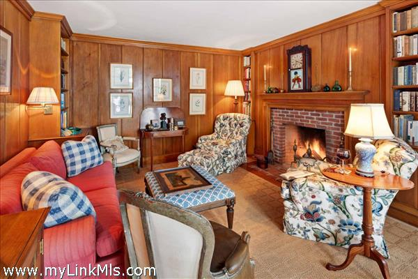 Main house den with brick fireplace