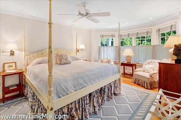 Main house guest bedroom with garden views