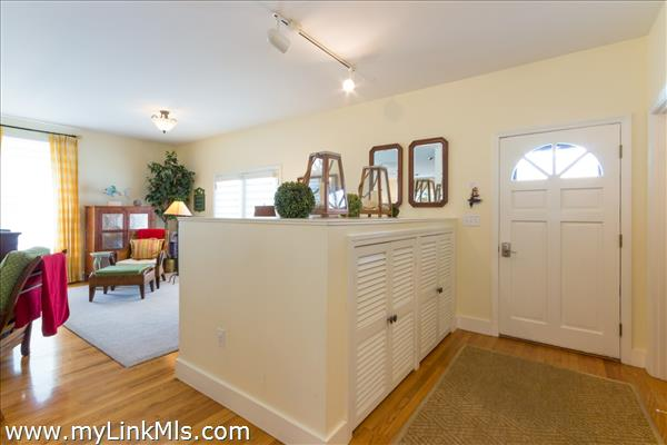 Foyer entrance with built in's for flip flops and outdoor accessories.