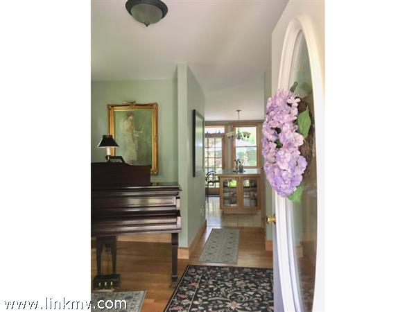Lovely Entry Hall doubles as a Music Room.