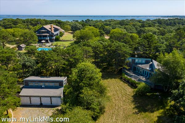 Aerial of House, 2nd dwelling, Bunk House, 4 bay garage, pool & Tennis Court