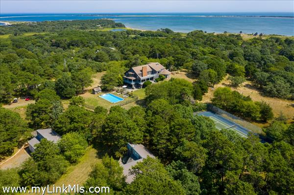 Aerial of House, 2nd dwelling, Bunk House, pool & Tennis Court with beach beyond