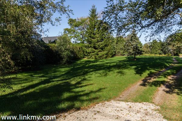 Half acre of land with mature trees.