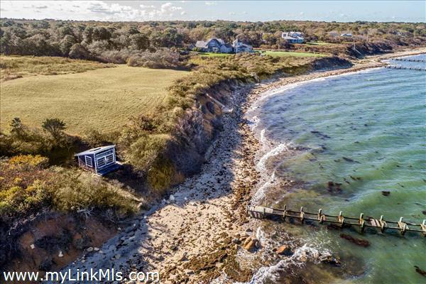 Charming cottage that can be used as a beach cabana or boathouse located near the water's edge.