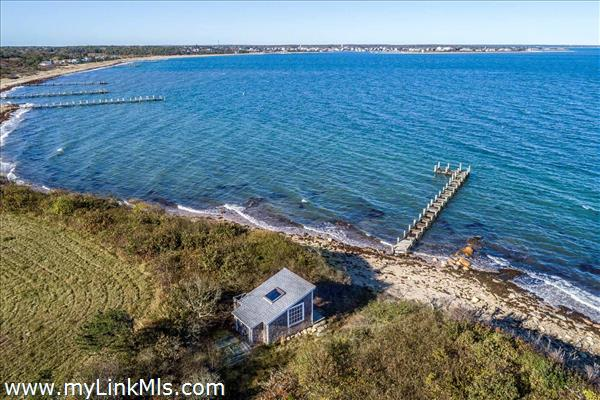 There is a small cottage near the water's edge that can be used as a beach cabana or boathouse.