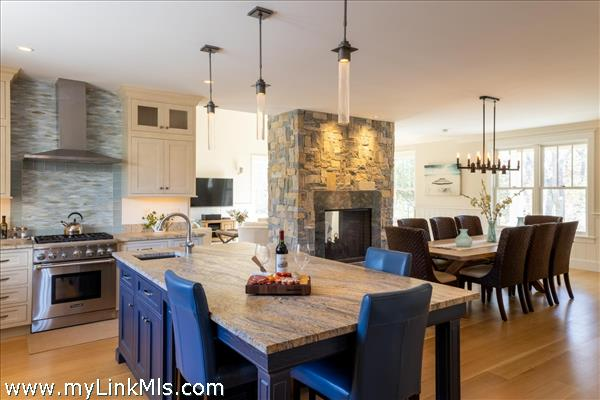 State of the art kitchen with leathered granite/quartz crossover countertops
