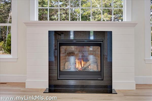 sample of gas fireplace with shiplap surround
